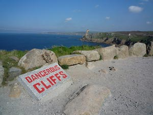 lands end with a sign saying 'dangerous cliffs'